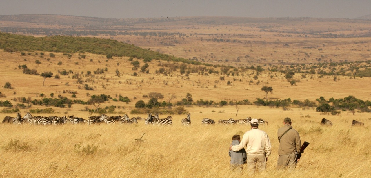 Walking in the Masai Mara at Cottar's 1920s safari camp and bush villa
