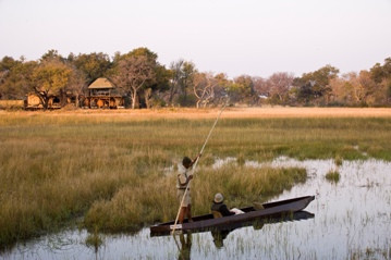 Peacefully gliding along in a mekoro at Xudum Okavango Delta lodge